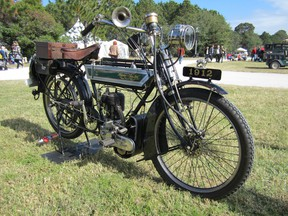This 1912 Abingdon King Dick motorcycle's rear wheel is driven by a dermatine linked leather belt.  The company also devised the first telescopic shock absorber.