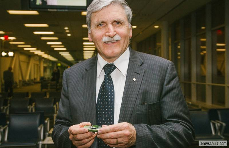 Lieutenant-General Romeo Dallaire holds Miguelito's Little Green Car.