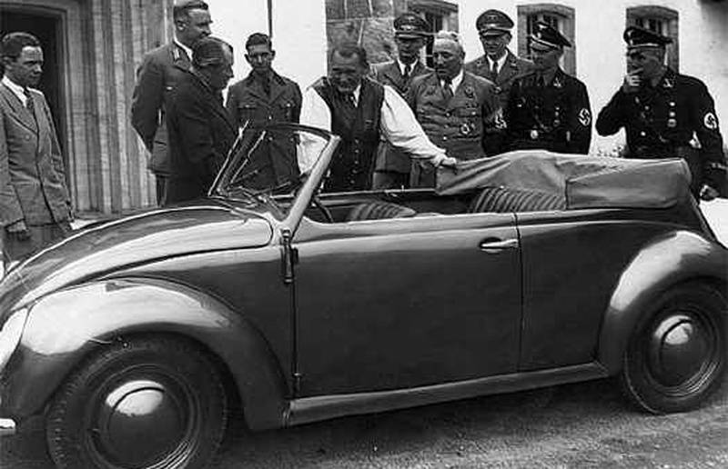 Adolf Hitler opened Ferdinand Porsche's first factory for the production of the 'People's Car,' the Volkswagen. Here Ferdinand Porsche shows the car to Hermann Goring..