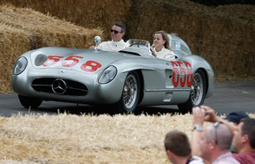 Williams reserve driver Susie Wolff driving a Mercedes Benz 300SLR  at Goodwood on June 26, 2015 in Chichester, England.