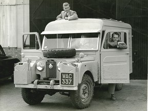 Robert Bateman and Bristol Foster picking up their new special order 1957 Land Rover in England before embarking on their world tour.
