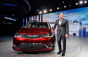 FCA head of passenger car brands Tim Kuniskis presents the Chrysler 2017 Pacifica minivan during the press preview of the 2016 North American International Auto Show in Detroit, Michigan, on January 11, 2016.