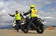 Desmond Rodenbour of High Gear Motorcycle Training gives tips to a client in Vancouver, B.C.