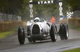 Pink Floyd drummer Nick Mason behind the wheel of the 1936 Auto Union Type C at Goodwood Festival of Speed.