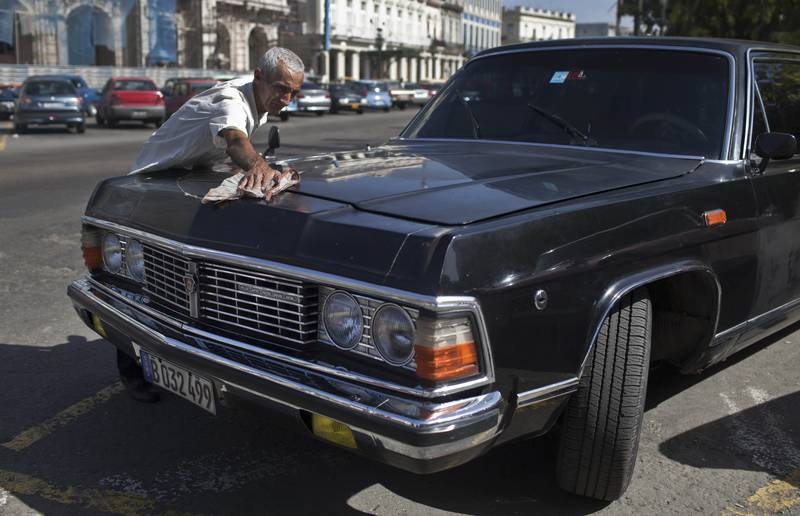 Taxi driver Moises Suarez cleans the Soviet-made ZiL limousine he drives, which was once part of Fidel Castro's fleet in Havana, Cuba. The fleet was often used to ferry around visiting dignitaries, and at least one of the limos was used occasionally by Castro himself, though he usually preferred a military-style Jeep for his own transportation needs.