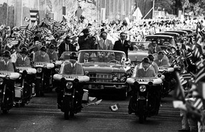 In 1976, thousands of Cuban people along the streets in Havana greet Prime Minister Pierre Elliott Trudeau as he accompanies Fidel Castro and then-president of Cuba, Osvaldo Dorticos