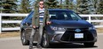 Reader review driver Richard Phillips stands with the 2017 Toyota Camry SE Hybrid he test drove.