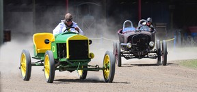 A couple of Model T racers kick up some dirt.