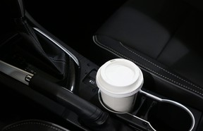 A coffee cup in the cupholder of a 2018 Toyota Corolla.
