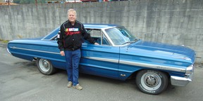 Wynn Hollingshead with his1964 Ford Galaxie XL that looks like a nicely restored original until the hood is opened or the massive engine is fired up.