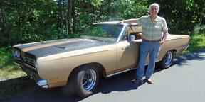 Montreal automotive writer and concours judge Michel Lamoureux with his restored 1969 Plymouth Roadrunner.