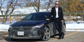 Gary Rokosh poses with a well-travelled 2018 Kia Stinger GT in Calgary.