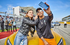 Lewis Hamilton and Millie Bobby Brown take a selfie ahead of a hot lap around the Circuit of the Americas.