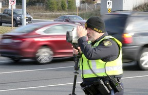 OPP Const. Mike Atkinson watches for speeding vehicles during traffic enforcement patrol in Windsor, Ontario November 14, 2017.