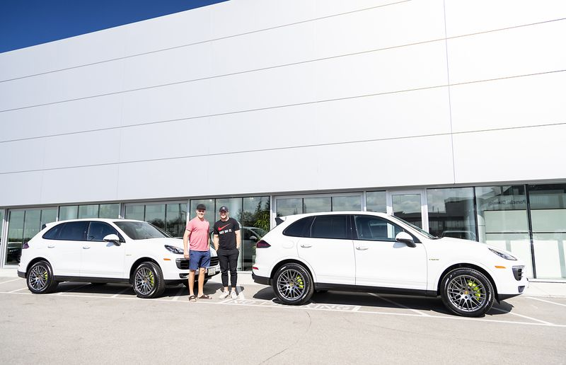 Toronto Maple Leafs Morgan Rielly and Jake Gardiner with their new Porsche Cayenne E-Hybrids