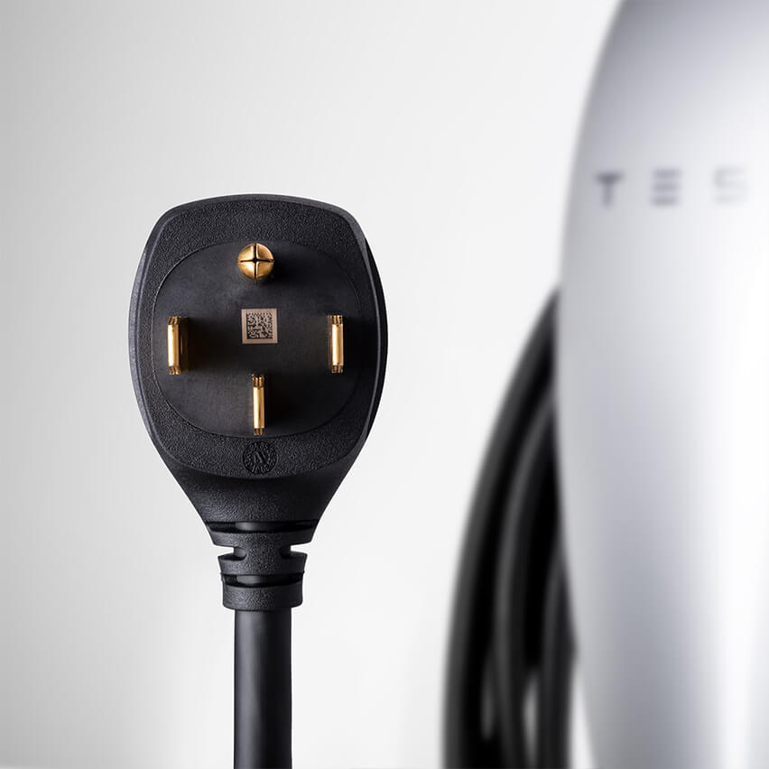 Tesla Wants Customers To Plug In Its New Wall Charger Wherever They Want Driving