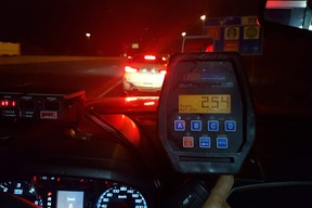 A radar gun with a recorded 254 km/h speed reading on it, shot March 2019 in Mississauga, near Toronto.