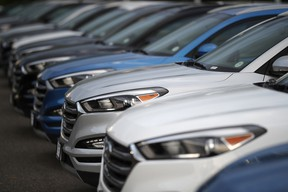 In this file photo, unsold Hyundai Tucson crossovers sit at a dealership in Littleton, Colo.