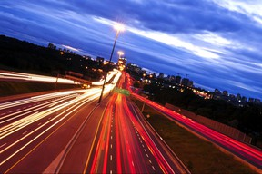 Night traffic on a busy city highway 401 in Toronto
