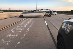 Boat blocks Toronto highway on Canada Day, sparks national caption contest