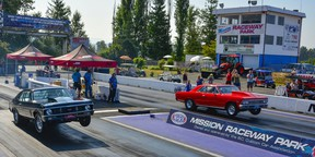 Two cars side by side pulling wheelies during last weekend's Langley Loafer Old Time Drags.