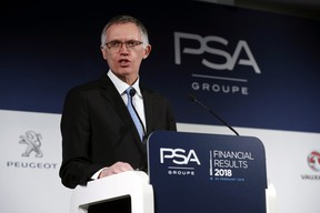 PSA Peugeot Citroen Chief Executive Carlos Tavares delivers a speech during the presentation of the company's 2018 full year results, in Rueil Malmaison, west of Paris, Tuesday, February 26, 2019.