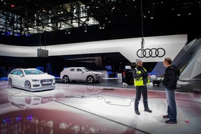 Workers are seen at the stand of German carmaker Audi on February 28, 2020 at the Geneva International Motor Show which has been cancelled after Switzerland banned large gatherings amid the new coronavirus epidemic.