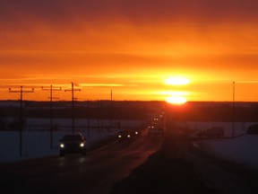 Rush hour traffic lines the horizon of a sunrise on March 18, 2014.