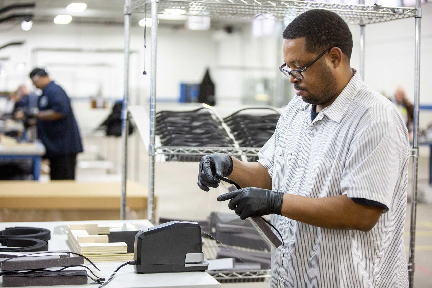 Ford factory operators and assemblers assemble medical face shields