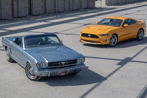 A 2018 and a 1965 Ford Mustang