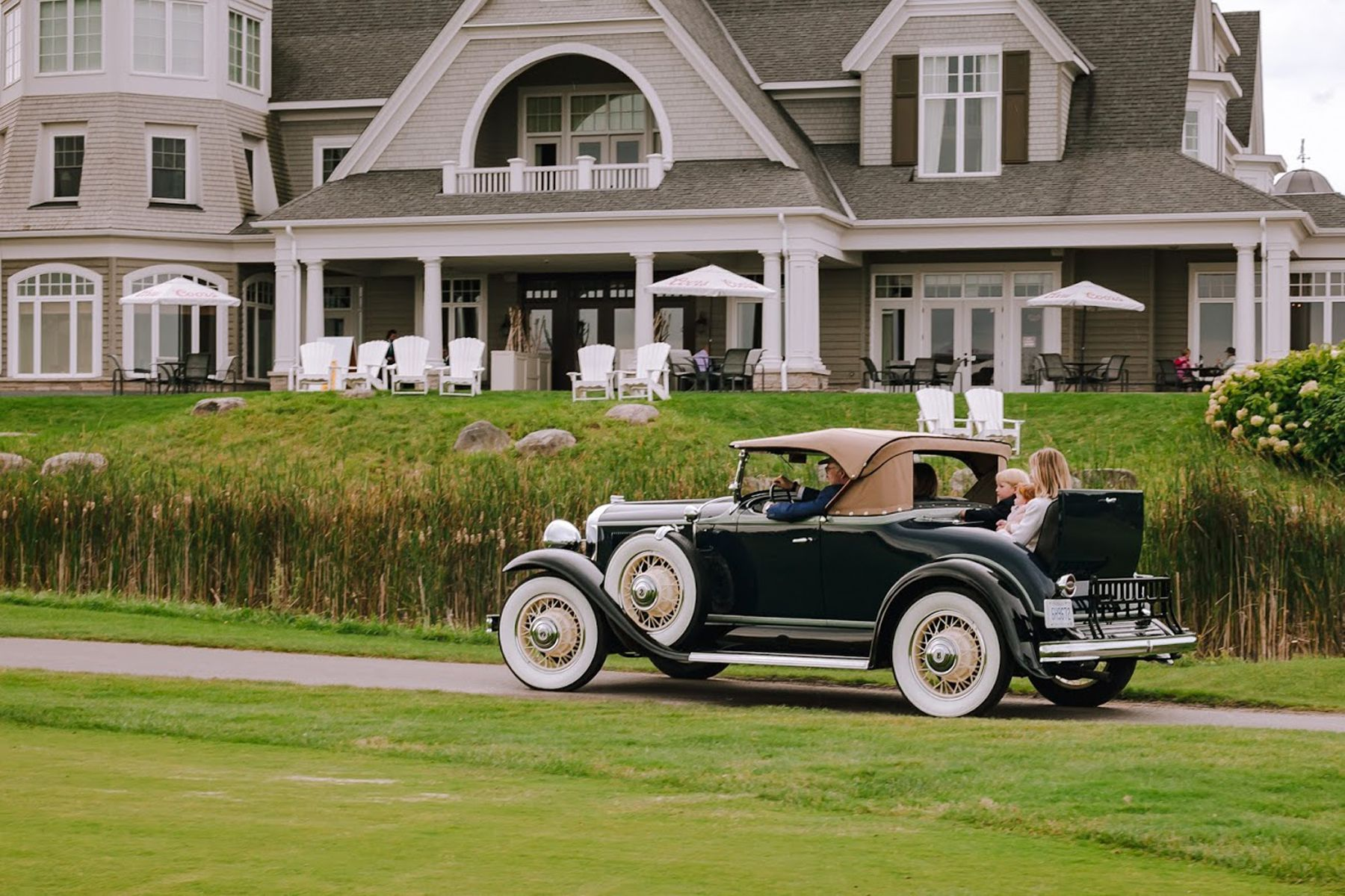 Rob and Rosemary McLeese and grandchildren ride in their restored 1931 McLaughlin-Buick sport roadster at the Cobble Beach Resort Community