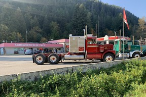 Classic big rigs line up at the Dogwood Valley Truck Stop in B.C.'s Fraser Canyon to honour Gail Marlatt for her years of providing home-cooked meals for drivers.