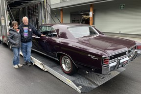 Garry and Darlene Cassidy taking delivery at their Langley showroom of the 1967 Chevelle SS, a car that was sold at the recent Barrett-Jackson auction by Vancouver dealer Wayne Darby.