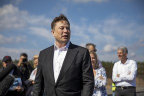 Tesla head Elon Musk talks to the press as he arrives to to have a look at the construction site of the new Tesla Gigafactory near Berlin on September 03, 2020 near Gruenheide, Germany.