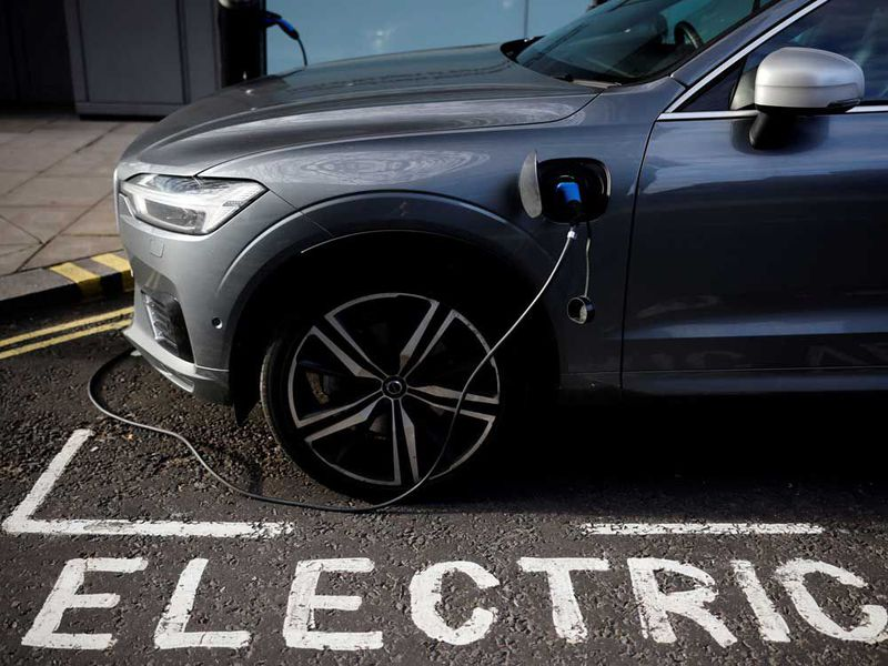 An electric Volvo parked in an EV charging spot.