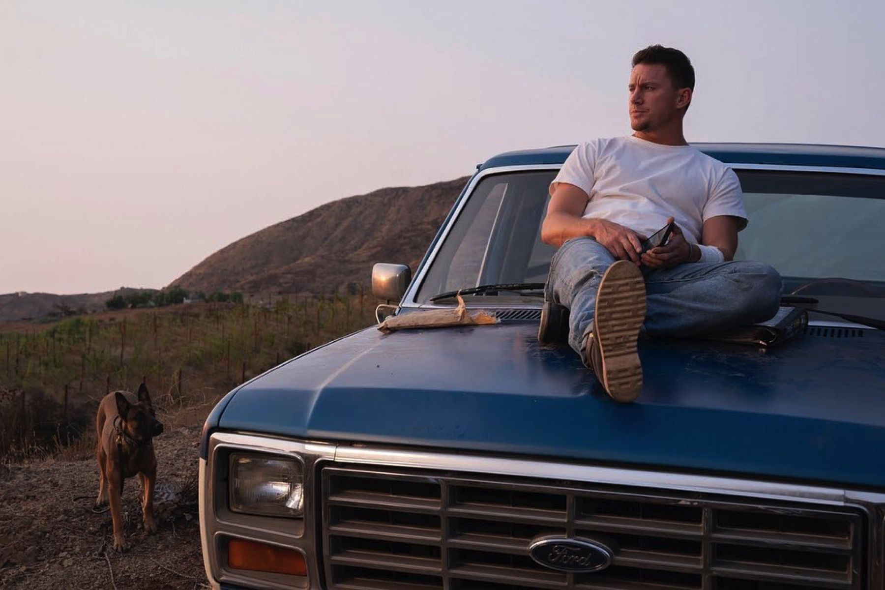 Channing Tatum sits on the hood of a Ford pickup