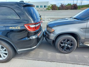 BMW X5 boxed in by police