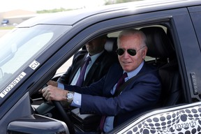 U.S. President Joe Biden tests the new Ford F-150 lightning truck as as he visits VDAB at Ford Dearborn Development Center in Dearborn, Michigan, U.S., May 18, 2021.