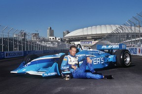 Hometown hero Greg Moore strikes a pose with his Indy car on the home straight at Vancouver's then-new Indy track in 1998.