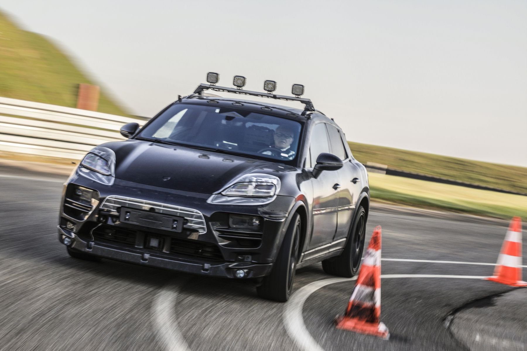 A prototype electric Macan completes a test at Porsche's development centre in Weissach