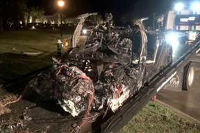 The remains of a Tesla vehicle are seen after it crashed in The Woodlands, Texas, April 17, 2021, in this still image from video obtained via social media.
