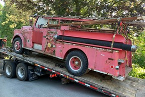 The 1954 Thibault pumper No. 13 gets unloaded for what will be a long, and for the volunteers probably very enjoyable, restoration.