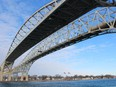 The twin spans of the Blue Water Bridge are shown from Point Edward. The Bluewater Bridge Corporation says passenger vehicle traffic was down significantly in 2020 because of pandemic restrictions. Paul Morden/The Observer