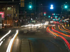 A long exposure shows the blurred lights of vehicles as they travel along Broad Street in Regina, Saskatchewan on May 2, 2020.