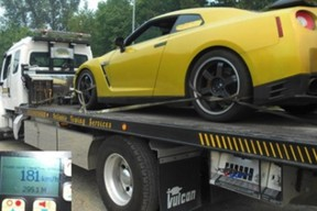 An impounded Nissan GT-R on the back of a tow truck in B.C.