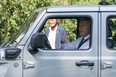 U.S. President Joe Biden gives a thumbs-up to guests while driving a Jeep Rubicon 4xe at an event for clean cars and trucks, and signs an executive order on transforming the country's auto fleet at the White House in Washington, U.S. August 5, 2021.