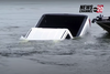 WATCH- News reporter accidentally catches GMC Sierra sinking into a lake live on TV