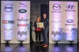 Lorraine Sommerfeld accepting the 2021 AJAC Journalist of the Year award from Jaguar's John Lindo