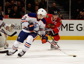 Ryan Nugent-Hopkins leads the charge out of Edmonton Oilers territory against Jonathan Toews and the Chicago Blackhawks. (Photo: Jonathan Daniel/Getty Images North America)