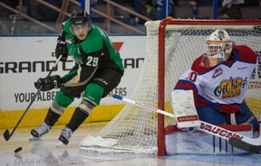 Prince Albert Raiders centre Leon Draisaitl looks for a possible wrap-around attempt against Oil Kings goaltender Tristan Jarry in Game 2 of a first-round Western Hockey League playoff series at Rexall Place on March 23, 2014.